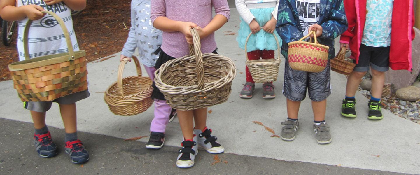 Children holding baskets
